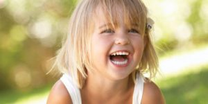 child with big smile